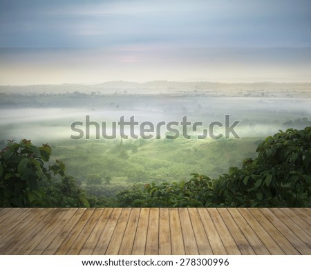 wood terrace with  view of Khaoyai national park  in the morning with sea of mist ,Thailand for background  - stock photo