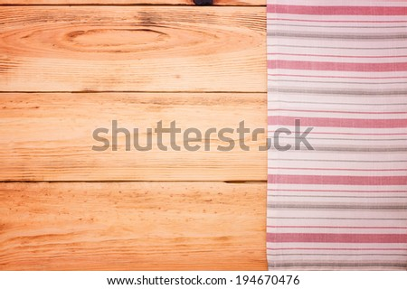 Wood texture background. Cutlery on red checkered tablecloth tartan. Wooden table close up view from top. Product pages for installation recipe books menu  - stock photo