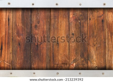 Wood texture background with metal frame - stock photo
