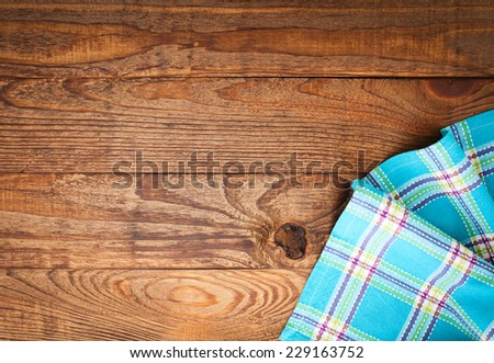 Wood texture background. Wooden table covered with tablecloth cloth checkered plaid red. View from top. Empty tablecloth for product montage for recording menu, recipe. Free space for your text  - stock photo