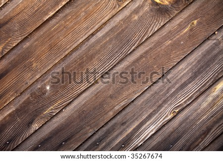 Wood texture on an old house - stock photo