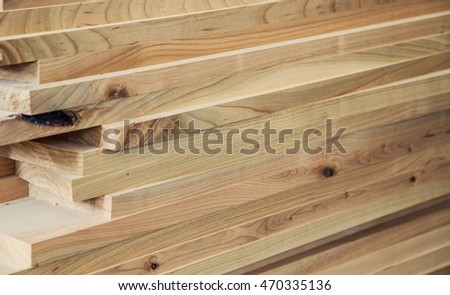 Wood timber construction material for background and texture. details wood production. composition wood products. abstract background. small depth of field