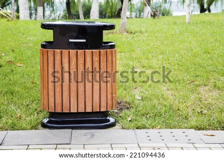 Wood trash bin in the park - stock photo