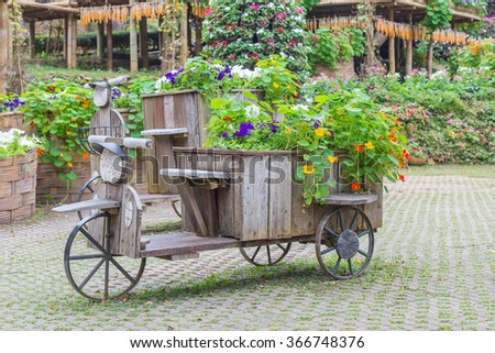 wood tray, motorcycle concept decoration in garden flowers - stock photo