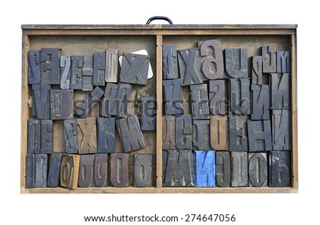 Wood Type Mixture in a desk drawer isolated on white with clipping path  - stock photo