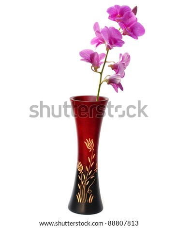 Wood vase and purple orchid - stock photo
