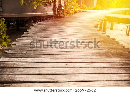 Wood walk path in mangrove forest. Vintage filter. - stock photo