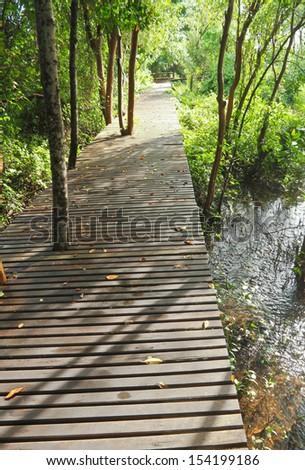 Wood walkway under soft sunshine - stock photo