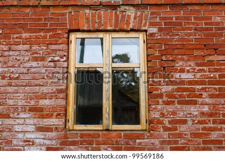 wood window in old red brick wall - stock photo