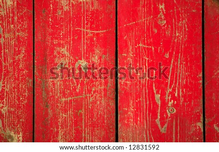 Wood with chipped red paint. Grunge style background - stock photo