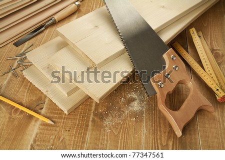 Wood work tools and planks. Including hand saw, nails, chisel. - stock photo