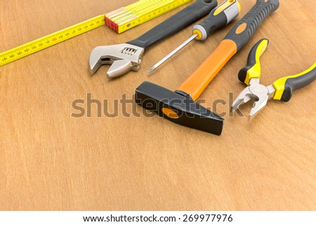 Wood working desk with different hand tools - stock photo