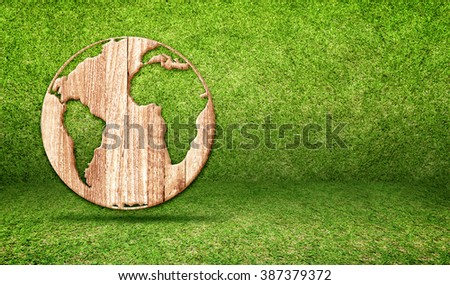 Wood world globe icon at green grass room,Ecology concept,Earth day, Leave space for adding your text - stock photo