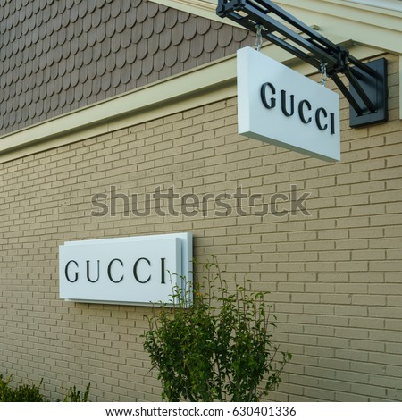 WOODBURY, NEW YORK - OCT 26 : Gucci signboard at Woodbury Common Premium Outlet on Oct 26, 2016 in Woodbury, New York, USA.