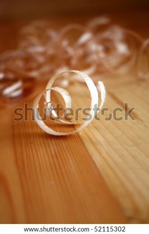 Woodchips on wooden surface - stock photo