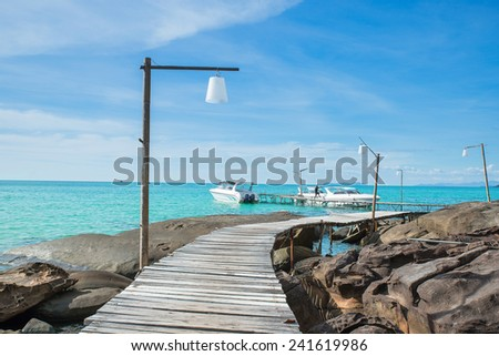 Wooded bridge in harbour against blue sky. Summer travel in Phuket ,Thailand. - stock photo