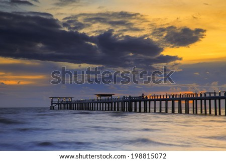 Wooded bridge in the beach island port along the sunrise time