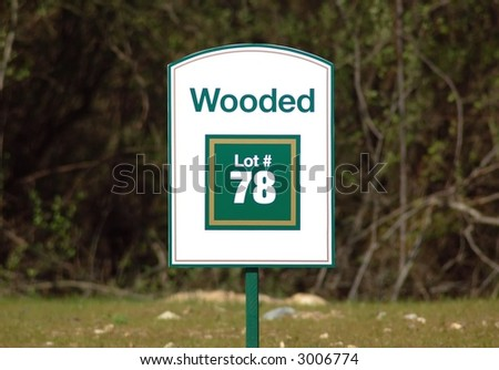 Wooded lot sign - stock photo