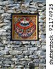 Wooded window and rock wall from bhutan culture, chiang mai flora exhibition - Thailand. - stock photo