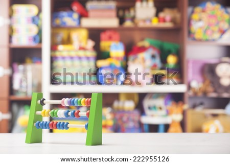wooden abacus in room for children - stock photo