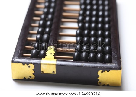 wooden abacus on white - stock photo
