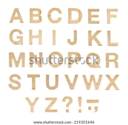 Wooden ABC letter alphabet set of latin letters and symbols made of clean pine wood, isolated over the white background - stock photo