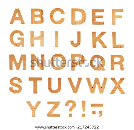 Wooden ABC letter alphabet set of latin letters and symbols made of light brown colored pine wood, isolated over the white background - stock photo