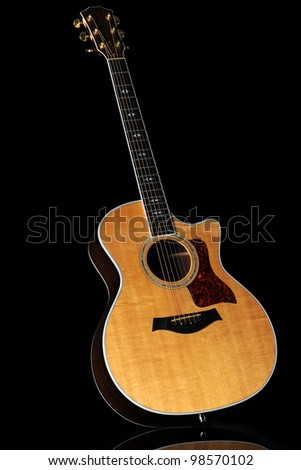 Wooden acoustic guitar over black background - With clipping path - stock photo