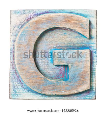 Wooden alphabet block, letter G - stock photo