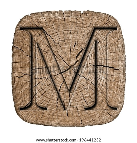 Wooden alphabet block,  letter M font Carved in wood, showing growth rings
