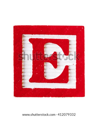 Wooden alphabet block with letter E isolated on white