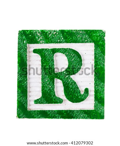 Wooden alphabet block with letter R isolated on white