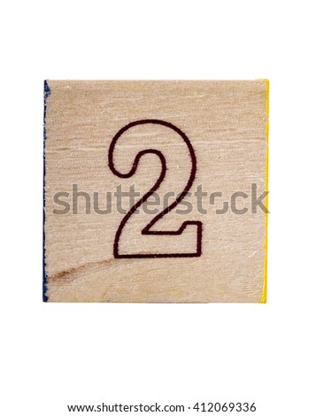 Wooden  alphabet block with number 2 isolated on white