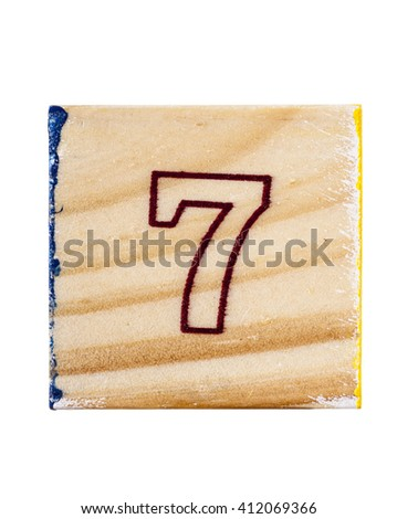 Wooden alphabet block with number 7 isolated on white