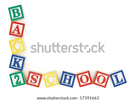 Wooden alphabet blocks at slight angles to each other arranged to form the words, 'back to school' in an 'L' shaped frame. Isolated on white with clipping path - stock photo