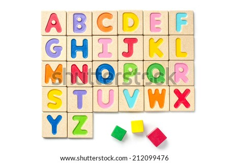 Wooden alphabet blocks with letters on white background - stock photo