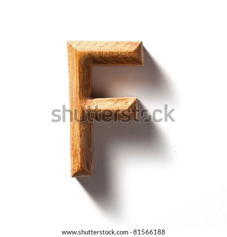 Wooden alphabet letter with drop shadow on white background, F - stock photo