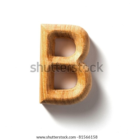 Wooden alphabet letter with drop shadow on white background, S - stock photo