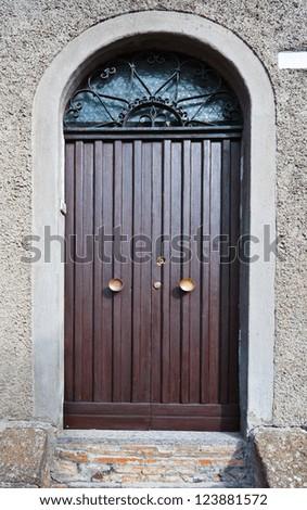 Wooden Ancient Italian Door in Historic Center - stock photo