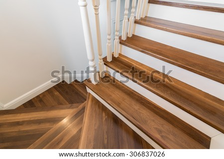 Wooden and elegant steps in modern storey house  - stock photo