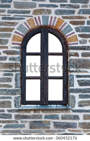 Wooden arched window in a stone wall isolated on white background - stock photo