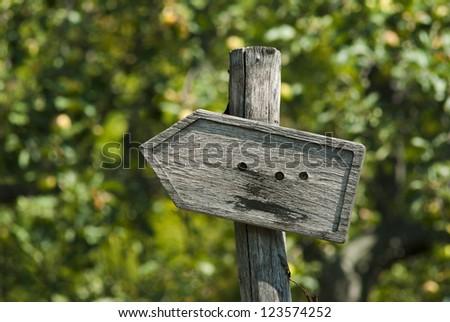 wooden arrow roadsign - stock photo