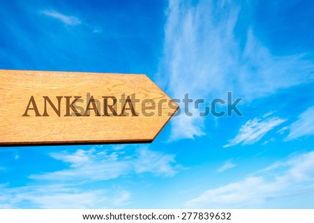 Wooden arrow sign pointing destination ANKARA, TURKEY against clear blue sky with copy space available. Travel destination conceptual image - stock photo