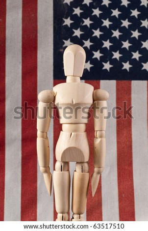 Wooden Art Doll in Attention Military Stance - stock photo