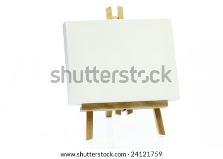 Wooden art easel on bright background. - stock photo
