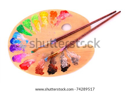wooden art palette with blobs of paint and a brush on white background - stock photo