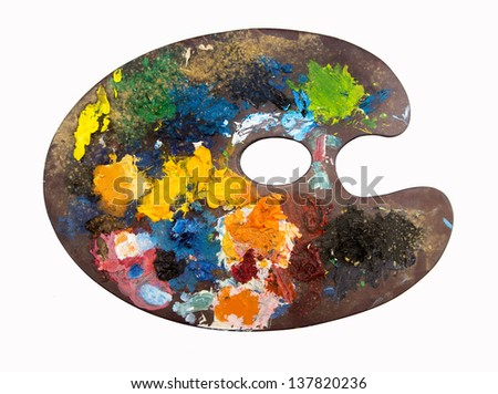 wooden art palette with blobs of paint and on white background - stock photo