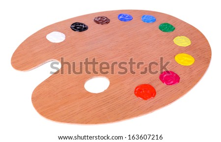 Wooden art palette with paint isolated on white - stock photo