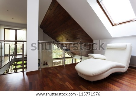 Wooden attic with corner for rest, stylish mezzanine - stock photo