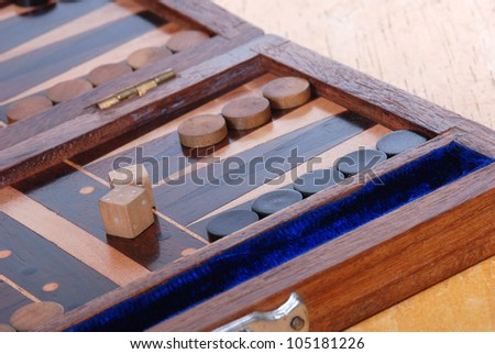 Wooden Backgammon boardgame with dice. - stock photo